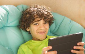 Smiling Boy Holding Tablet